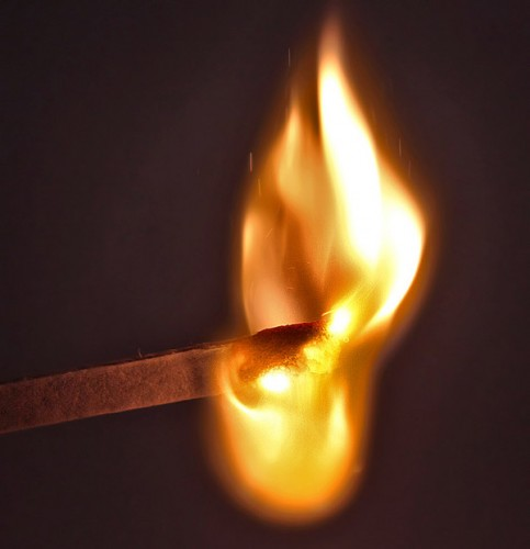 Image of match igniting.